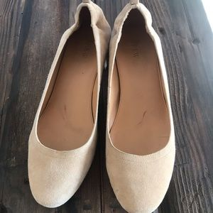 Tan suede shoes with low block heel.